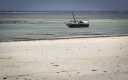 Old barque moored at an African beach. In Kenya royalty free stock photography
