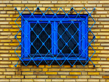 Old barred window in brick wall Stock Image