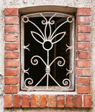 Old barred window on the wall Stock Photo