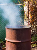 Old barrel, adapted to incinerate waste in the suburban area Royalty Free Stock Photography