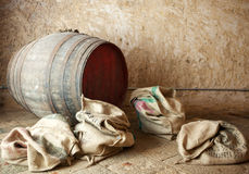 Old barrel with burlap sacks. Old barrel with burlap sacks, ancient ambience Royalty Free Stock Photography
