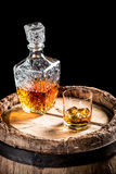 Old barrel and a glass of Scotch Stock Photography