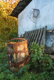 Old barrel near the house. Old fence Stock Image