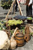 Old barrel and tools for wine production and baskets with grapes.  stock image