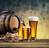 Old barrels and beer glasses. Tinted in yellow and blue Royalty Free Stock Photos