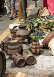 Old barrels and tools for wine production and baskets with grapes.  royalty free stock photography