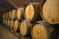 Old barrels in a wine cave Stock Photo