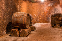Old Barrels in the Wine Cellar Stock Images