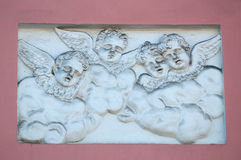 Old bas-relief figures of angels Stock Photo
