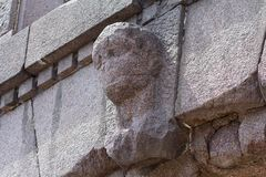 Old bas-relief in the form of the human head on a building facade. Architecture Stock Photo