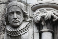 Old bas-relief made of stone in Christian Church. Melancholy face Stock Images