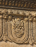 Old bas-relief with mythical ornament on the ancient temple Stock Photo