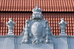 Old bas-relief on the roof Stock Photos