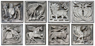 Old Bas-reliefs Of Fairytale Animals Royalty Free Stock Photo