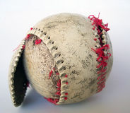 Old Baseball. Photo of an old torn up baseball Royalty Free Stock Images