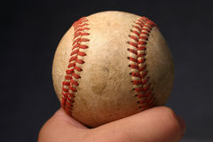 Old Baseball. Person holding old baseball in hand Royalty Free Stock Photography