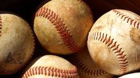 Old baseball. S in a bucket after a long season Stock Photos