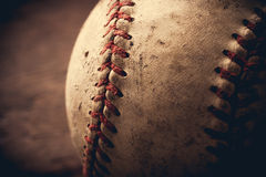Old baseball background. Old baseball on wooden background and highly closeup Stock Photo