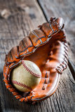 Old baseball ball and glove Stock Images