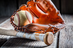 Old baseball ball and golden glove Royalty Free Stock Image
