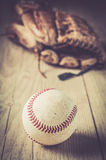 Old baseball ball sport glove over n aged Royalty Free Stock Images