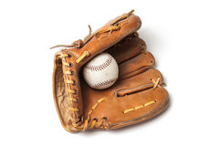 Old baseball with a baseball glove Stock Images