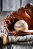 Old baseball bat and glove with ball Stock Image