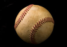 Old Baseball on Black Royalty Free Stock Photography
