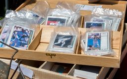 Old baseball cards in plastic bags. Bags of old baseball cards are packaged for sale at an antique event in Michigan USA royalty free stock images