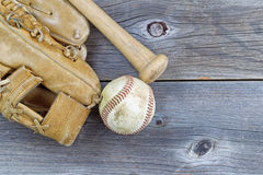 Old Baseball equipment on Aged Wood Royalty Free Stock Image
