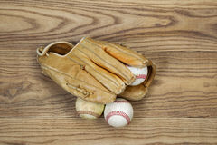Old Baseball Gear on aged wood Stock Photos