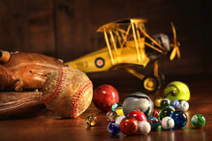 Old baseball and glove with antique toys Royalty Free Stock Photo