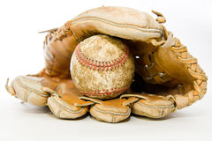 Old baseball glove and ball. Old baseball glove with scuffed up baseball in pocket of glove Stock Photos