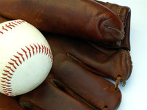 Old baseball glove and ball. Vintage baseball glove and a baseball royalty free stock photos