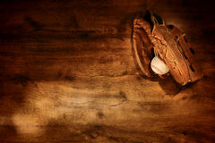 Old Baseball Glove and Ball on Wood Background stock photography