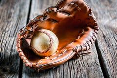 Old baseball glove and ball Stock Image
