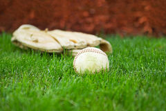 Old Baseball and Glove on Field Royalty Free Stock Photos