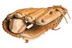 Old baseball in leather mitt or glove Stock Photo