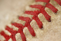 Old Baseball macro. Macro image of an old baseballs red threads Stock Images