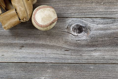Old Baseball Mitt with used ball on rustic wood Royalty Free Stock Photography