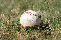 Old baseball in the outfield Royalty Free Stock Photography