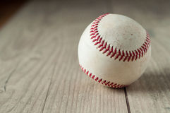 Old baseball on wooden background and highly closeup. Old baseball on wooden background  and highly    closeup Stock Photos