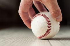 Old baseball on wooden background and highly closeup. Old baseball on wooden background  and highly    closeup Royalty Free Stock Images