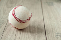 Old baseball on wooden background and highly closeup Stock Photo