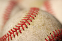 Old Baseballs. Close up of old baseballs with selective focus. Baseball in the front is in focus the balls in the back are out of focus Royalty Free Stock Image