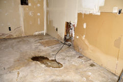 Old basement. Distressed basement wall and floor in an old home Royalty Free Stock Photography