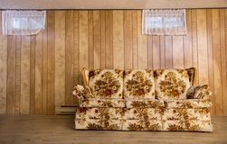 Old basement couch. Old couch from the 70s, in a basement Royalty Free Stock Image