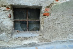 Old. A basement window from a very old building located in the old city near the narrowest street in Europe Stock Images