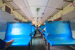 Old basic blue seats in a train of Yangon Circular Railway in Myanmar Royalty Free Stock Photos