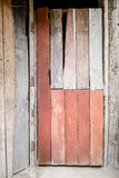 Old and basic red painted wood door of old traditional wooden thai house Royalty Free Stock Photos
